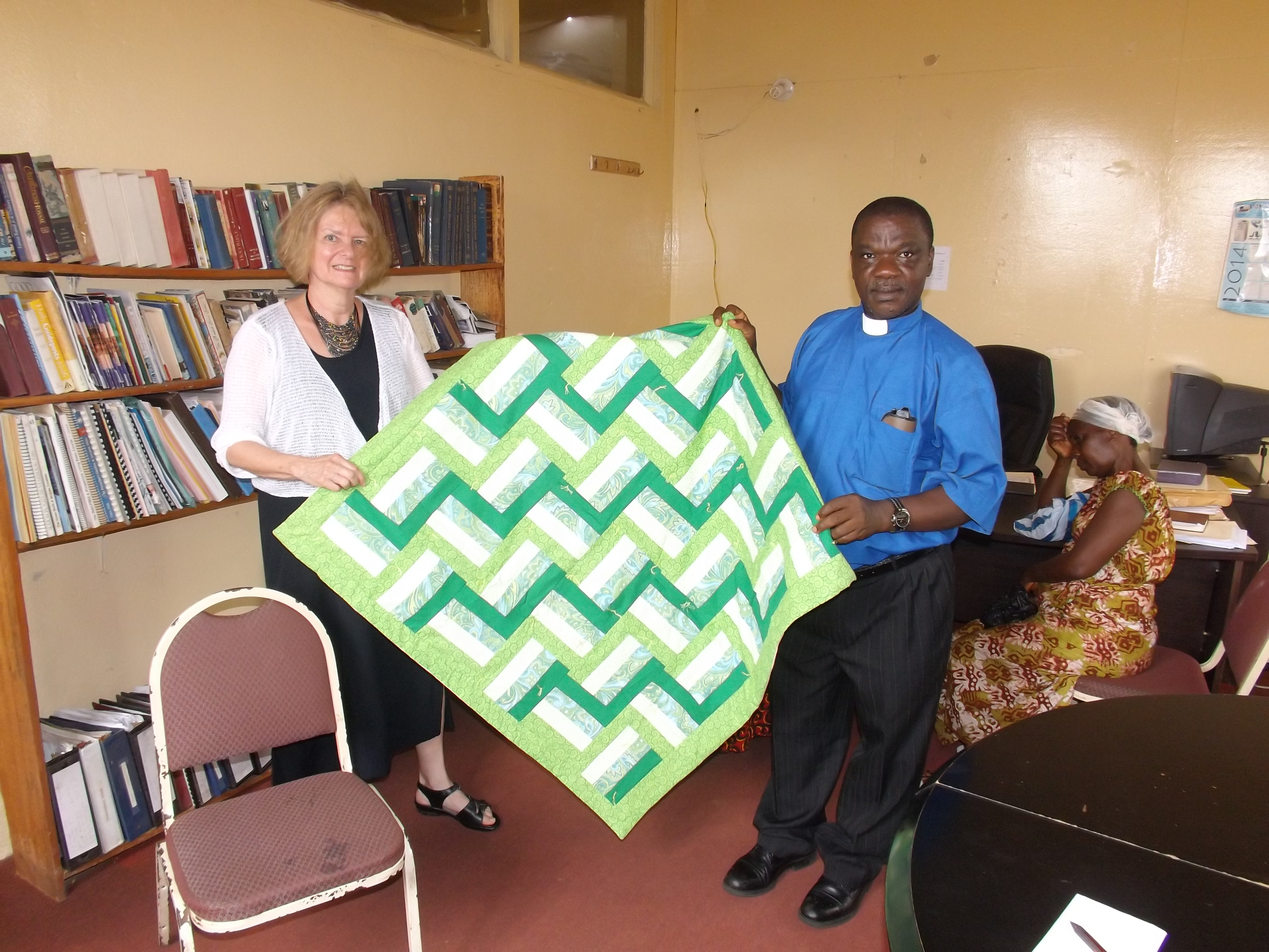 Monrovia District Superintendent receiving the Hope Prayer Quilt